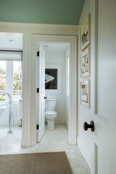 A stalled water closet separates the toilet from the rest of the master bathroom. The state-of-the-art toilet features a touch-free flush and built-in sensors for alerting the homeowner of tank leaks, a feature that is designed to save both water and money.