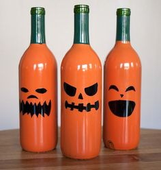 Wine Bottle Pumpkins Keep wine bottles from the recycle bin with Krylon Dual Gloss spray paint (hunter green and mandarin), Sharpie markers and masking tape. They are so easy to turn into these decorative pumpkins!