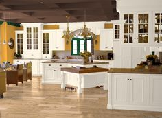 Add spice in a kitchen with pops of mustardy gold. (Shown on the walls is Pratt & Lambert Burnished Gold 11-13.)