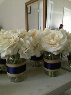 I like the idea, except I want just straight clear glass vases and yellow and eggplant carnations.