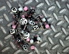 https://www.etsy.com/listing/106662969/halloween-pink-and-black-lampwork-charm?ref=v1_other_2