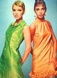 Models wearing lurex party dresses, 1960s