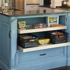 Just For Kids  The kitchen table is often the hub of arts and crafts projects, so designate a nearby cabinet to keep supplies out of sight...