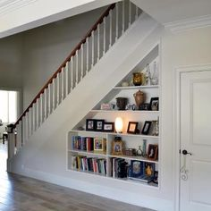 Home Design: When building a home, you may be surprised by all the choices, including staircase style and location. Get helpful staircase design tips. Shelves Under Stairs, Stair Bookshelf, Closet Under Stairs, Space Under Stairs, Bookshelves, Basement Stairs, Foyers, Under Stairs Storage Solutions, Home Engineering