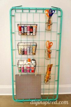 An old bed spring can be repurposed as a rack to hang things on. | 45 Organization Hacks To Transform Your Craft Room