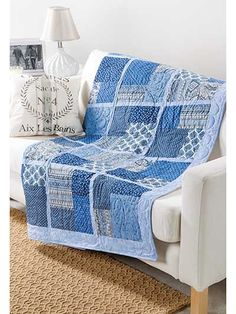 """An irresistible combination of textures and colors creates a striking quilt.   Use traditional colors and elegant textures to make up this handsome Exclusively Annie's quilt. It's super simple and easy to change up the pattern by twisting and turning the Four-Patch blocks, and the easy design will go with just about any decor and fit anyone's taste. Sample shown was made using Subtle Charm Blue fabric(shown). Finished size is 57"""" x 70"""".  Also available in a quilt kit (listed below) using…"""