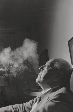 Mies van der Rohe with smoke, 1957; photographed for Life magazine. Courtesy Frank Scherschel/Time & Life Pictures/Getty Images.