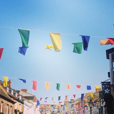 Flags for Flora day, Helston, Cornwall 8th May 2014. Colourful bunting. Street party.