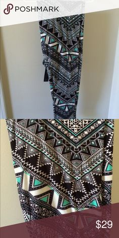 Super soft LuLaroe like leggings These are gorgeous and oh so soft!  Black and white with a hint of teal.  These are Tall and Curvy or plus size which generally fits 14/16-32/34. Pants Leggings