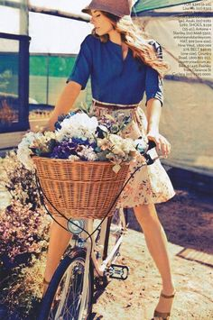 Summertime bicycle and basket with flowers