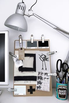 Keep inspiration boards within easy reach by propping them up on a desk easel.