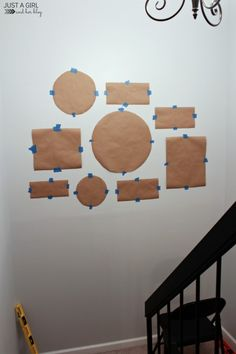 Tip for making a gallery wall: trace the frames first and arrange stencils on the wall before nailing holes. How to Create a Gallery Wall in 5 Easy Steps | JustAGirlAndHerBlog.com