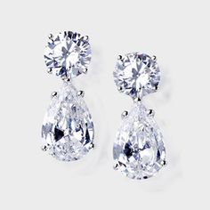 24.0 CTW Round and Pear  14K Drop Earring. High quality cubic zirconia classic drop earrings feature a 4.0 carat brilliant round top with a 8.0 carat pear drop. An approximate 24.0 total carat weight. These exquisite cubic zirconia drop earrings measure over 1 inch long. Set in 14k white gold, also available in 14k yellow gold via special order. Cubic zirconia weights refer to equivalent diamond carat size.