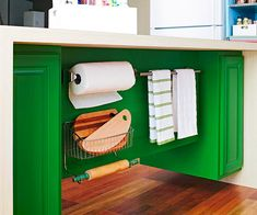 Not all storage belongs behind closed doors. Make oft-used items easy to find and access when you outfit the food-prep side of an island with affordable add-ons: bars for tea towels and paper towels, as well as a repurposed wire bin to house cutting boards and rolling pins.