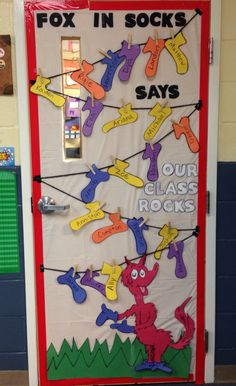 "Dr. Seuss - Fox in Socks - classroom door decoration - ""Fox in Socks says our class rocks!"" - National Read Across America Month - students add a sticker to their sock for each book they complete"