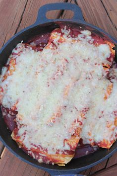 Recipe for Cast Iron Skillet Enchiladas with a homemade enchilada sauce ~ freezer friendly! | 5DollarDinners.com
