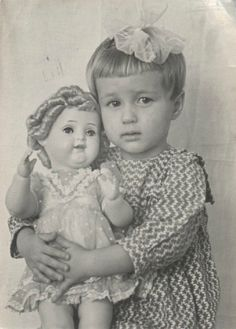 Little girl with her Shirley Temple doll