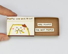 This listing is for one matchbox. This is a great alternative to a traditional greeting card. Surprise your loved ones with a cute private message hidden in these beautifully decorated matchboxes!  Each item is hand made from a real matchbox. The designs are hand drawn, printed on paper and then hand colored in to give each individual matchbox that special personalized touch. Weve found that these matchboxes are the perfect way to brighten someones day :)  Dimensions: 2 1/16 (length) x 1...