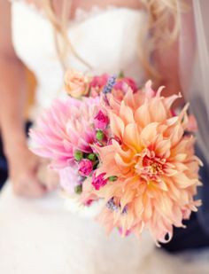 Lovely bridal bouquet with huge purple and orange dahlias