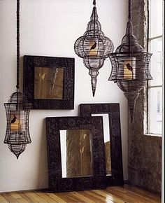 Bird cage lanterns hanging from ceiling hooks above tub, or bird cages with candles resting on the tub would look so cool in the master bath!