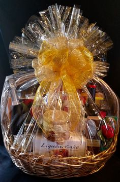 Over the Top Gift Basket with 2 bottles of wine (red and white), many gourmet items, cheese board, cheese knife.