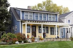 Via SoPo Cottage -- love the row of windows above the shed dormer.