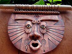 Mayan Sun God ceramic wall mask art  https://www.etsy.com/listing/81868266/mayan-sun-man-ceramic-mask