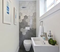 Decorating With Hexagonal Tile: Trendy Hex Tile Projects For Your Kitchen Or Bathroom Small format hexagonal tile is a timeless classic, not to mention one of the go-to features for cottage style bathrooms. But while those tiny tiles are Hexagon Tile Bathroom, Hex Tile, Hexagon Tiles, Bathroom Feature Wall Tile, Cement Tiles, Mosaic Tiles, Tiny Powder Rooms, Modern Powder Rooms, Powder Room Decor