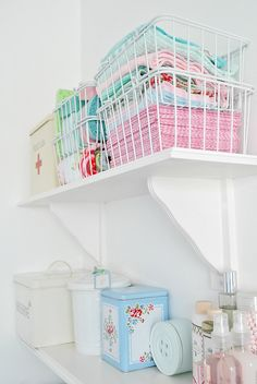 laundry room... wire baskets on open shelving