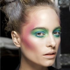 """This trend is about layering creams and powders to build intensity,"" explains Chanel celebrity makeup artist Kate Lee. ""If you want to try combining more than two colors, but are not sure you can pull off the blush, eye, and lip, then just use a hint of a shade: a blue liner to line the eye rather than applying blue to the whole lid. Try washes of color—a cream blush that shines pink rather than bright matte pink, or a red tint on lips and cheeks rather than a block of color."""
