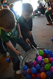 scoop up the colored balls from one bucket with serving spoons and race across the room to drop them in another bucked
