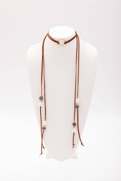 """One of my all-time favorite creations. This adjustable long 47 leather-and-pearl lariat necklace has 8 rare baroque pearls, spaced with golden beads. Each pearl is as unique and natural as you are. These pearls are rated as """"A"""" quality and vary in size between 13 and 14 mm."""