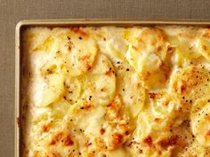 Get Four-Cheese Scalloped Potatoes Recipe from Food Network