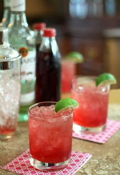 bacardi cocktail - grenadine simple syrup, bacardi rum, lime, sparkling mineral water, and a lime slice to garnish