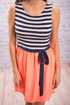 Don't drift too far away with those daydreams you're havin' right now! We know it's easy to get wrapped up picturing where you'll wear this striped and bright number, but you can bet a dress this eye-catching won't be around long! It's comfy, cute and easy to complete! Just add a great pair of sandals or wedges and you're good to go! Material has a fair amount of stretch. Miranda is wearing the small.