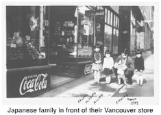 Japanese family in front of their Vancouver store