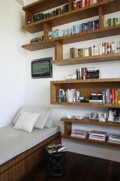 Love the floating shelves and the books arranged by color.
