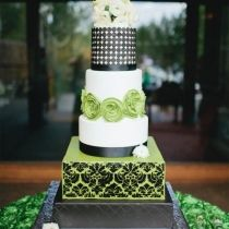 Modern black, green and white wedding cake with sugar leather dots, damask and fresh flowers by Sweet and Swanky Cakes.