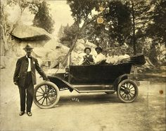 """Tourists in a Ford Model T at the """"Devil's Den"""" at Gettysburg Battlefield in Pennsylvania, c1910-1915"""