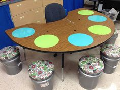 Dry erase circles and bucket seats! Guided reading tables should be a cute and productive space!