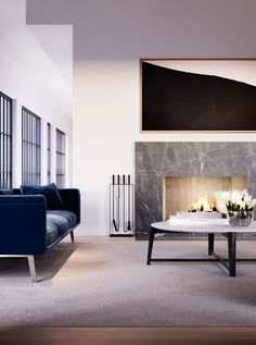 The penthouse's spacious living room is a great place to gather in all seasons. The room is anchored by a modern fireplace that becomes the focal point during the colder months. And in the summer, the nearby terrace doors can be opened to welcome fresh air and light.
