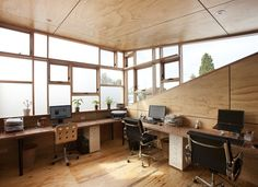 Fun (and huge) windows and treehouse-style wood floor