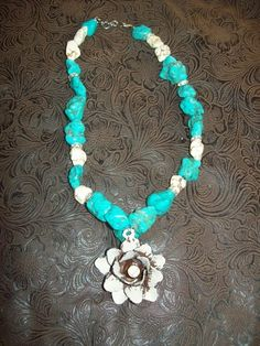 @Tara Harmon Harmon Lampkins ....likethe white and turquoise dont love the charm though Western jewelry necklace