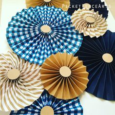 Blue and Kraft Brown Paper Rosettes, Paper Fans Backdrop, Blue Gingham, Little Blue Truck Party, Rustic Party, Farm Party, Blue and Brown by PicketFenceArts on Etsy https://www.etsy.com/listing/507966579/blue-and-kraft-brown-paper-rosettes