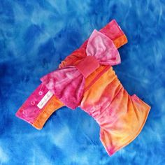"Booty-full (OSFM) Kimono inspired nappy. Made from a full cut of Wickedly Woven 'Bohemian Spirit' minky with accents in Orange and Pink.. Detachable Lil Bumaz ""Sugar Rush"" bow.    Lined in white stay-dry microfleece and includes hemp/microfiber trifold insert, topped with microfleece."