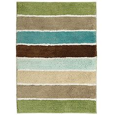 Entry way rug - brings together green in living room, tan in family room and blue from kitchen and bath.