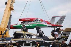 Oh Boy! Oberto is lifted back to the pits after heat 4A at the hydroplane races.