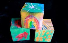 Artful DIY wooden blocks to make with melted crayon art on wood and painted with liquid watercolors. Great gift idea for kids to make or receive.