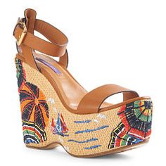 Skilled artisans hand-embroidered the Eralise's straw-and-cork heel with a colorful beach scene, inspired by vintage travel posters. Wear the Italian-made style with a cigarette jean during the day and a dress at night to add a dose of playful chic to your look.