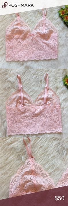 """Victoria's Secret almost vintage pink bralette Victoria's Secret bralette. ALMOST VINTAGE since it was made in 2002!!!! These are very hard to find! Excellent condition as I'm too pale to wear this color. Baby/light pink color. Bow on front. Adjustable straps. Yellow lining all around top inside (unnoticeable when wearing) that has cracks throughout from being old (see last pic). Please feel free to ask questions or submit offers if you're interested :)   Length approx 14"""" (can get longer or…"""